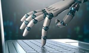 Robot hand on computer keyboard