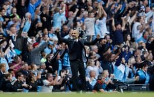 Guardiola celebrates as City retake the lead.