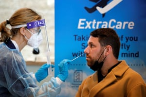 A health worker takes the antigen test, developed by Sheba Medical Center, at Ben Gurion international airport near Tel Aviv, in Lod, Israel on 8 March, 2021.