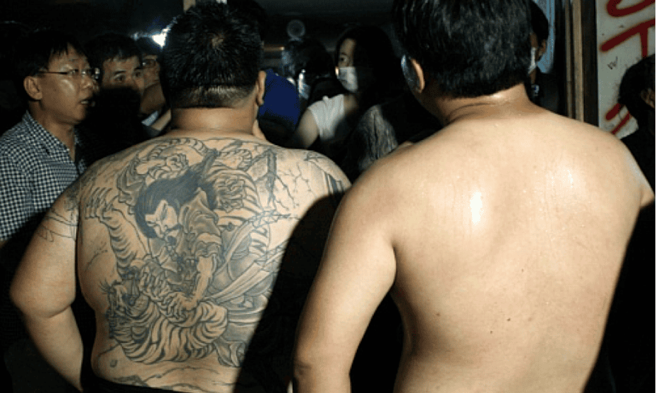 The 'thugs' who beat up activists trying to occupy the Mari Cafe in 2011.