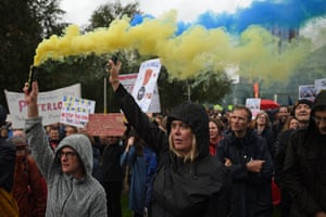 Demonstrators in Manchester let off flares as they join in with the protest