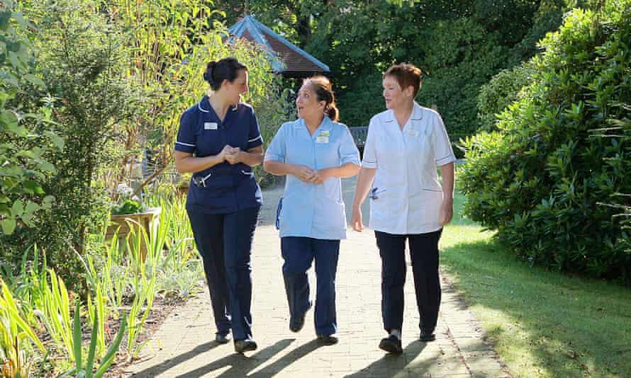 Nursing staff in the garden at St Gemma's Hospice, Leeds.