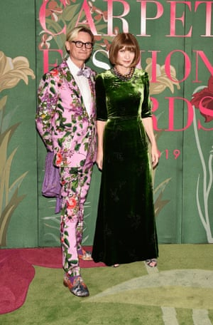 Hamish Bowles and Dame Anna Wintour on the green carpet, made from rescued fishing nets and other nylon waste, and recycled or repurposed after the event.