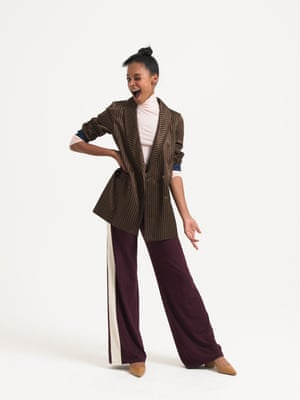 Model wears brown and gold striped blazer, £281, gestuz.com. burgundy white palazzo pant, £79, and pale pink roll-neck, £89, both meandem.com. brown animal print heels, £35, asos.com.