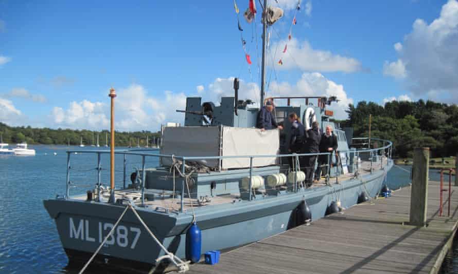 Buckler's Hard Maritime Museum, Hampshire. Men on a second world war-era (small) boat.