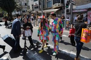 People in costume attend celebrations in Bnei Brak in Israel