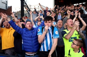 Huddersfield Town fans applaud their team after The Terriers' defeat, combined with victories for Burnley and Southampton, confirmed the visitors' demotion back to the Championship.