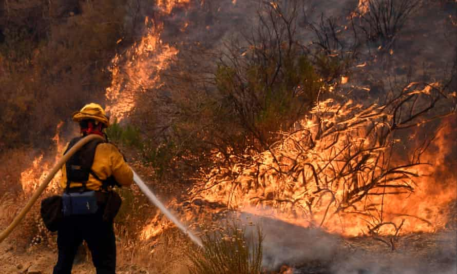 A fire fighter battles the so-called Sand Fire in the Angeles National Forest near Los Angeles, California, United States, July 25, 2016. REUTERS/Gene Blevins