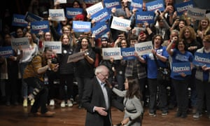 Bernie Sanders is greeted by Alexandria Ocasio-Cortez during a rally in Ames, Iowa, on 25 January.