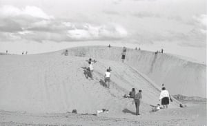 People play on Cronulla's sand dunes in 1963.