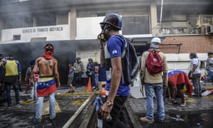 Anti-government activists set a police station ablaze in Caracas