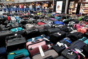 Düsseldorf, Germany. Hundreds of suitcases in the check-in area of the airport after a technical malfunction forced passengers to leave