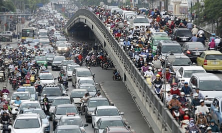 Commuters are seen during rush hour on a street in Hanoi