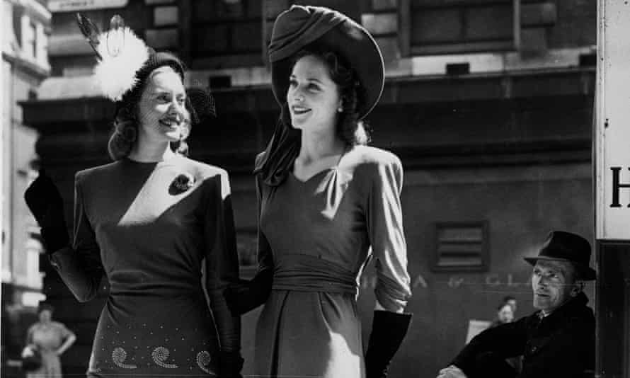 Hat trick: two women are admired by an onlooker in the mid-1940s.