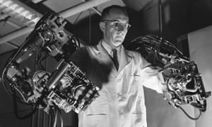 General Electric  engineer Ralph Mosher using a robotic exoskeleton he developed in the 1950s.