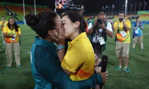 Marjorie Enya and rugby player Isadora Cerullo kiss
