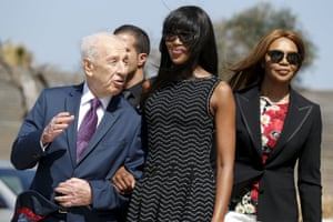 Jaffa, Israel British model Campbell stands with former Israeli President Peres upon her arrival to an event marking International Women's Day at the at the Peres Center for Peace