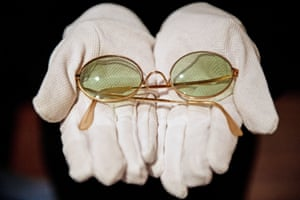 London, England. John Lennon's sunglasses are displayed at Sotheby's, where they are estimated to sell for £8,000 at auction