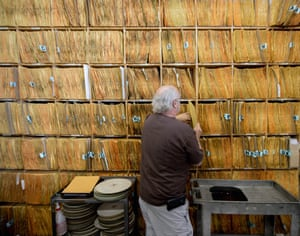 Rick Hashimoto files away a stamper at the record pressing plant