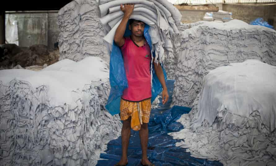 Raw hide: a leather worker in a tannery in Dhaka poses with hundreds of skins.