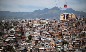 Cable cars travel over the Complexo do Alemao slum in Rio de Janeiro, Brazil