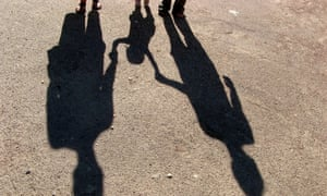 Shadows of a family holding hands