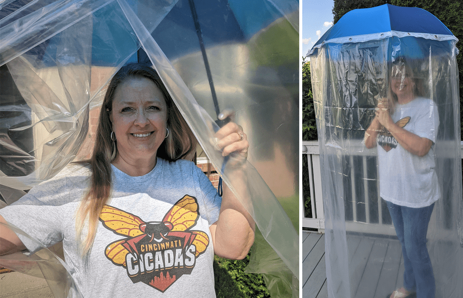 Jane Pyron with her anti-cicadas outfit, featuring an umbrella draped with shower curtains