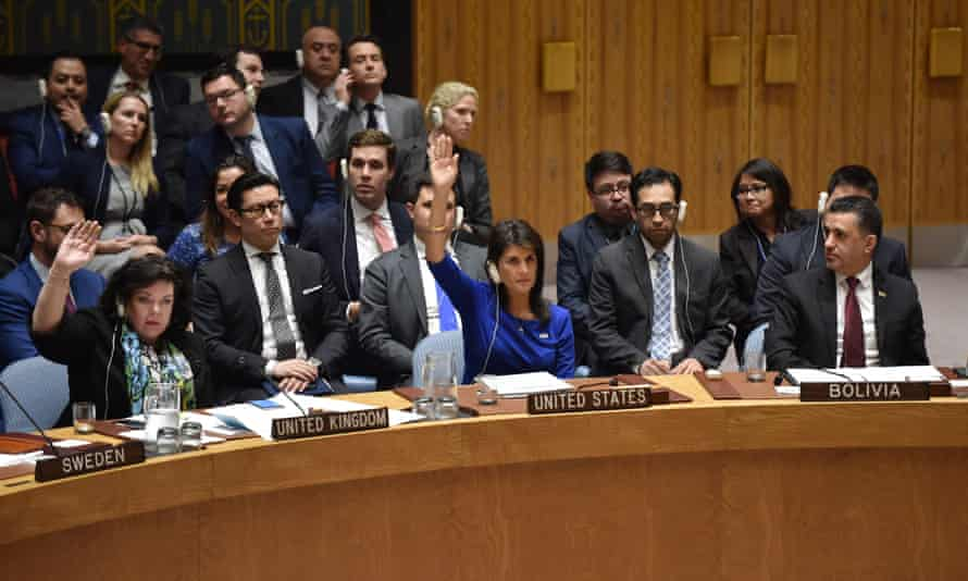 British ambassador to the UN Karen Pierce (L) and US ambassador to the UN Nikki Haley (C) vote during a UN security council meeting, at the United Nations Headquarters in New York, on 14 April.