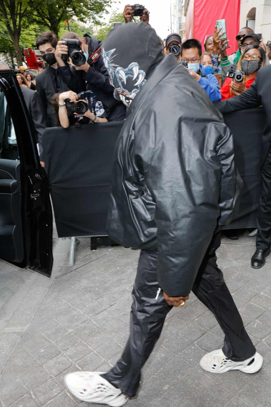 Kanye West wearing the 'go round' jacket at the Balenciaga show in Paris last week.