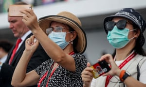Spectators wearing protective masks at the Singapore Airshow on 11 February.