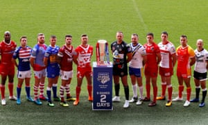Super League players pose with the trophy.