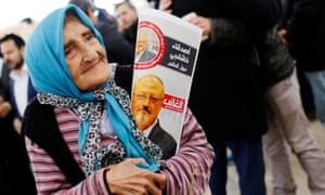 A woman holding a picture of Jamal Khashoggi at the courtyard of Fatih mosque in Istanbul