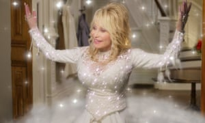 A gift from Dolly ... Parton in a still from the upcoming Netflix film, Dolly Parton's Christmas on the Square.