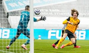 Newcastle United goalkeeper Martin Dubravka saves from Wolverhampton Wanderers' Fabio Silva.