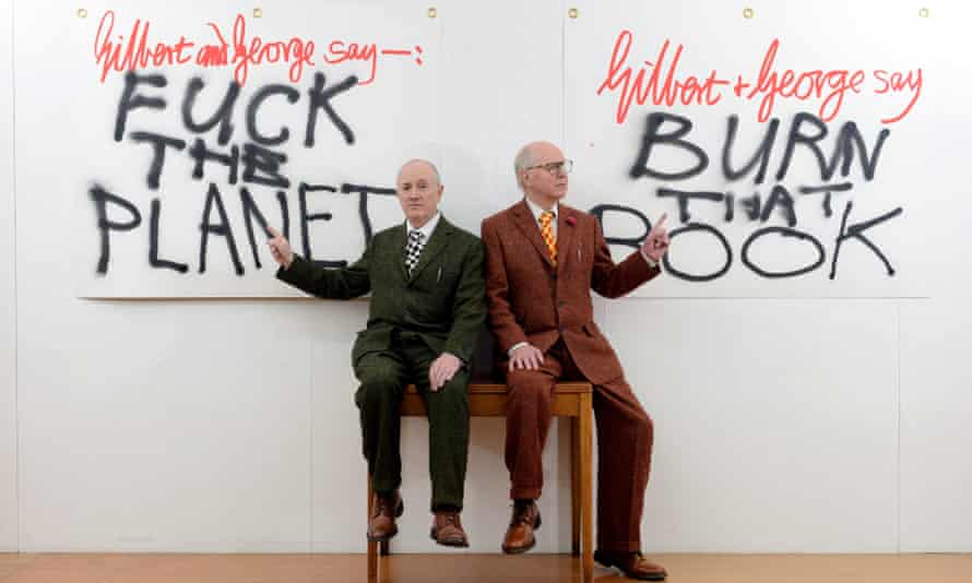 Gilbert and George with two banners from their White Cube gallery exhibition.