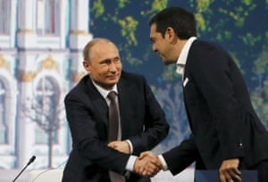 Russian President Vladimir Putin (L) shakes hands with Greek Prime Minister Alexis Tsipras during a session of the St. Petersburg International Economic Forum 2015 (SPIEF 2015) in St. Petersburg, Russia, June 19, 2015. Greece's debt crisis is a problem for all of Europe and the European Union faces a choice between showing solidarity with Greece or sticking to austerity policies that lead nowhere, Tsipras said on Friday. REUTERS/Grigory Dukor TPX IMAGES OF THE DAY