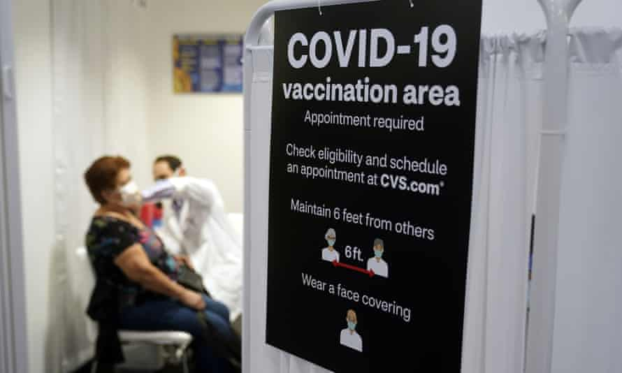 A patient receives a vaccine in Los Angeles. California has struggled to institute a smooth vaccine sign-up process.