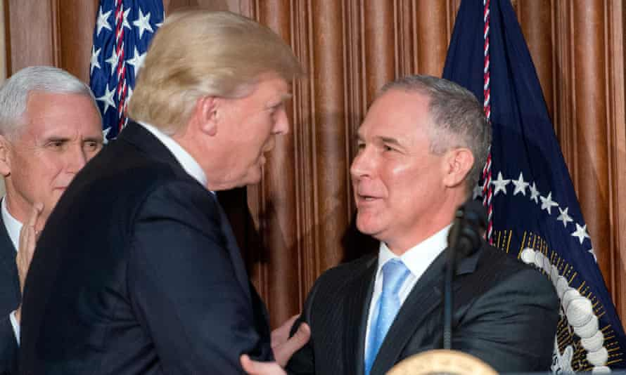 President Donald Trump and his EPA administrator Scott Pruitt shake hands at the signing of an executive order unraveling America's efforts to combat climate change.