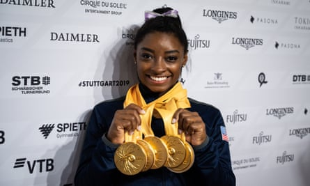 Simone Biles poses with her five gold medals from this year's World Championship