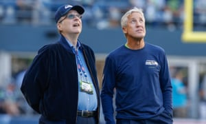 Pete Carroll, pictured here with team chairman Paul Allen, will need more than his trademark long-sleeved jersey in Minnesota.