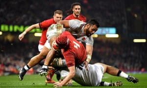 Cory Hill goes over for Wales's first try, which swung the match in their favour.