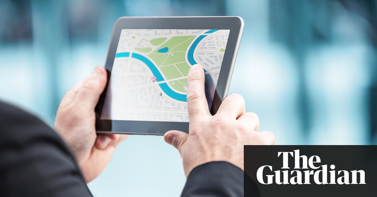 Person Looking At A Location On Map Tablet