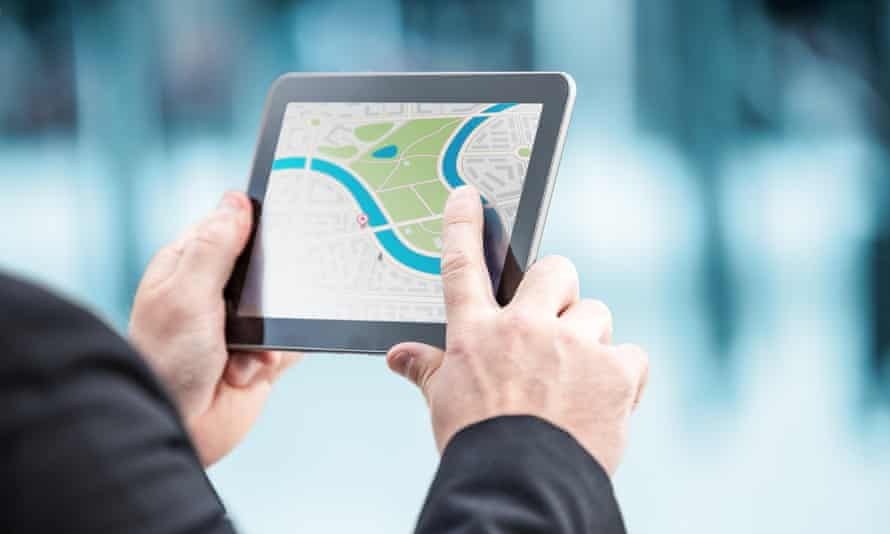 Person looking at a location on a map on a tablet