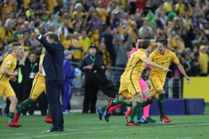 Despite conceding a late goal, the final whistle soon blows and Australia's substitutes rush onto the pitch.