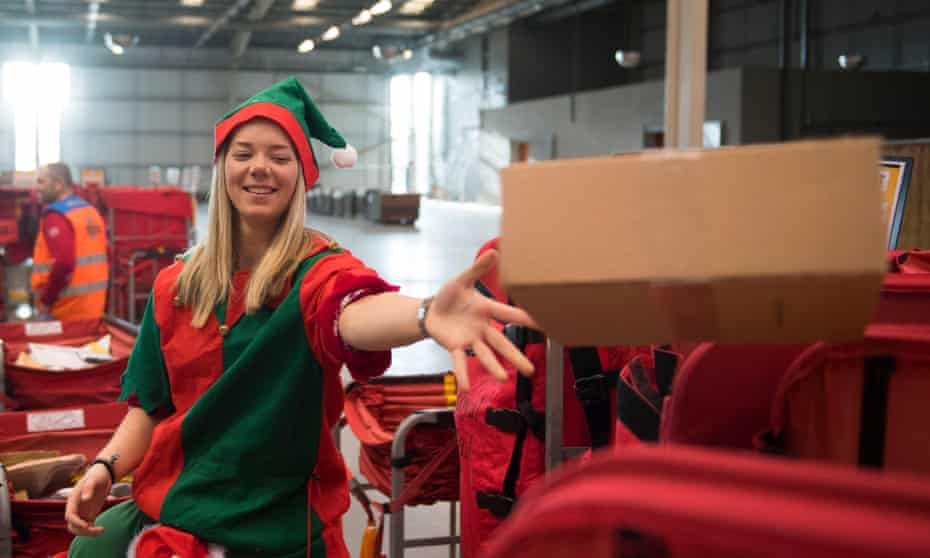 A Royal Mail temp workers processes mail at the sorting office in Llantrisant, South Wales