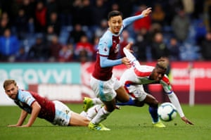 Crystal Palace's Wilfried Zaha in action with Burnley's Charlie Taylor and Dwight McNeil as Palace win 3-1 away at Turf Moor.
