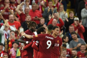 Liverpool's striker Divock Origi (left) celebrates with teammates after he scores their fourth goal.
