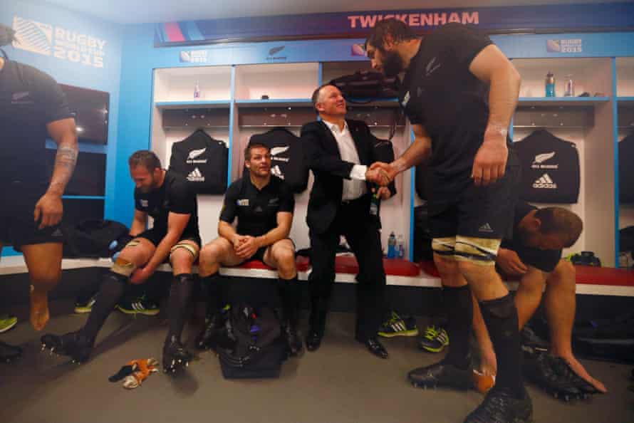 Former New Zealand prime minister John Key congratulates Samuel Whitelock after the 2015 Rugby World Cup semifinal match between South Africa and New Zealand in London.