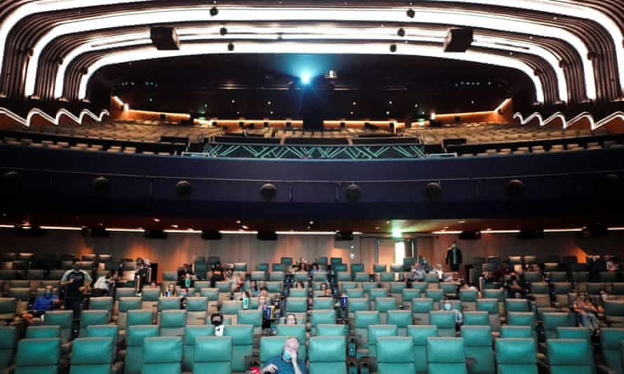 People take their seats inside the Odeon Luxe Leicester Square cinema on the opening day of the film Tenet in London.
