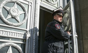 A police officer outside the Russian foreign ministry where European ambassadors were summoned to be informed of the expulsions of diplomatic staff.